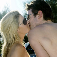 Couple in sunglasses kissing
