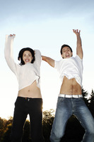 Couple jumping up with joy
