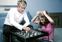 Couple playing chess game