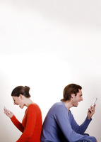 Couple screaming into mobile phone