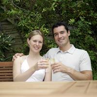 Couple smiling at the camera while holding glasses of champagne