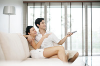 Couple watching movie together at home