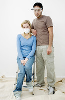 Couple with protection mask and goggles posing for the camera