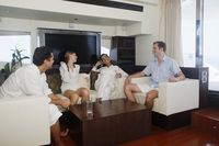 Couples relaxing in yacht living room