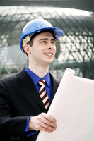 Engineer with safety helmet holding a plan