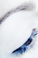 Eyelash with blue mascara applied