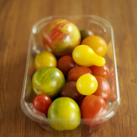 Fresh tomatoes in a transparent container