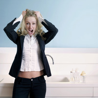 Frustrated businesswoman pulling her hair while screaming