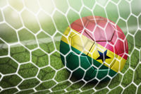 Ghana soccer ball in goal net