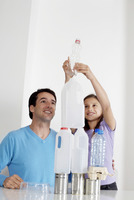 Girl and man stacking recyclable items