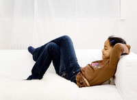Girl crossing her legs while resting on the couch