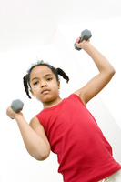 Girl lifting up dumbbells