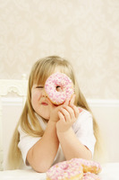 Girl looking through the donut