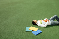 Girl lying on the field