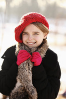 Girl with red hat and glove, smiling