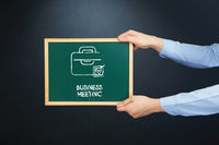 Popular : Hands holding blackboard with business meeting concept