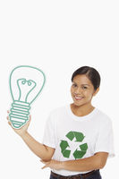 Happy woman holding up a cardboard light bulb