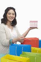 Happy woman holding up a gift box