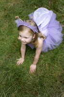 High angle view of little girl wearing ballet dress