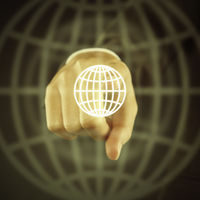 Index finger pointing at a digital graphic globe