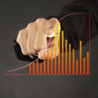 Index finger pointing at a graph chart