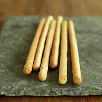 Italian sesame breadsticks on slate