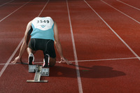 Male athlete crouching on starting line
