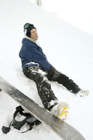 Male snowboarder with injured leg
