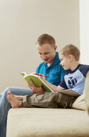 Man and boy reading book