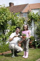Man and girl gardening