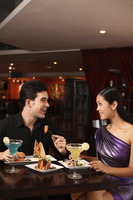 Man and woman chatting while having dinner together