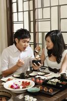 Man and woman enjoying food in restaurant