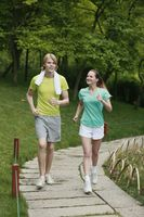 Man and woman jogging in the park