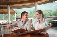 Man and woman reading menu in a restaurant