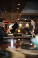 Man and woman reading menu in restaurant