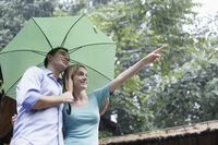 Man and woman sharing an umbrella