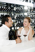 Man and woman sitting at bar counter talking