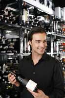 Man choosing a bottle of wine from the wine cellar