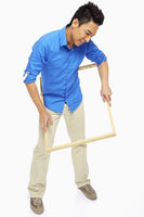 Man going through a picture frame