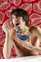 Man having breakfast cereal