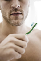 Man holding toothbrush with toothpaste