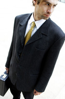 Man in business suit carrying a briefcase