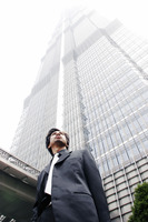 Man in business suit standing in front of the building