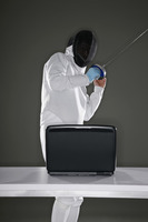 Man in fencing suit moving away from laptop