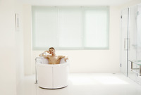 Man sitting in the bathtub with his eyes closed