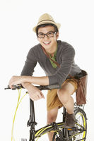 Man sitting on the bicycle, smiling