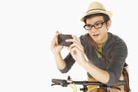Man taking pictures with mobile phone