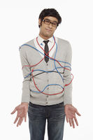 Man wrapped in network cables