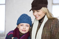 Mother and daughter in winter clothing