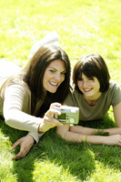 Mother and daughter taking picture in the park